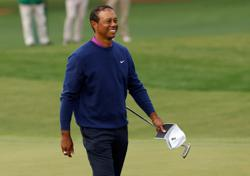 Golf-Stricker wants Woods as U.S. Ryder Cup team vice-captain
