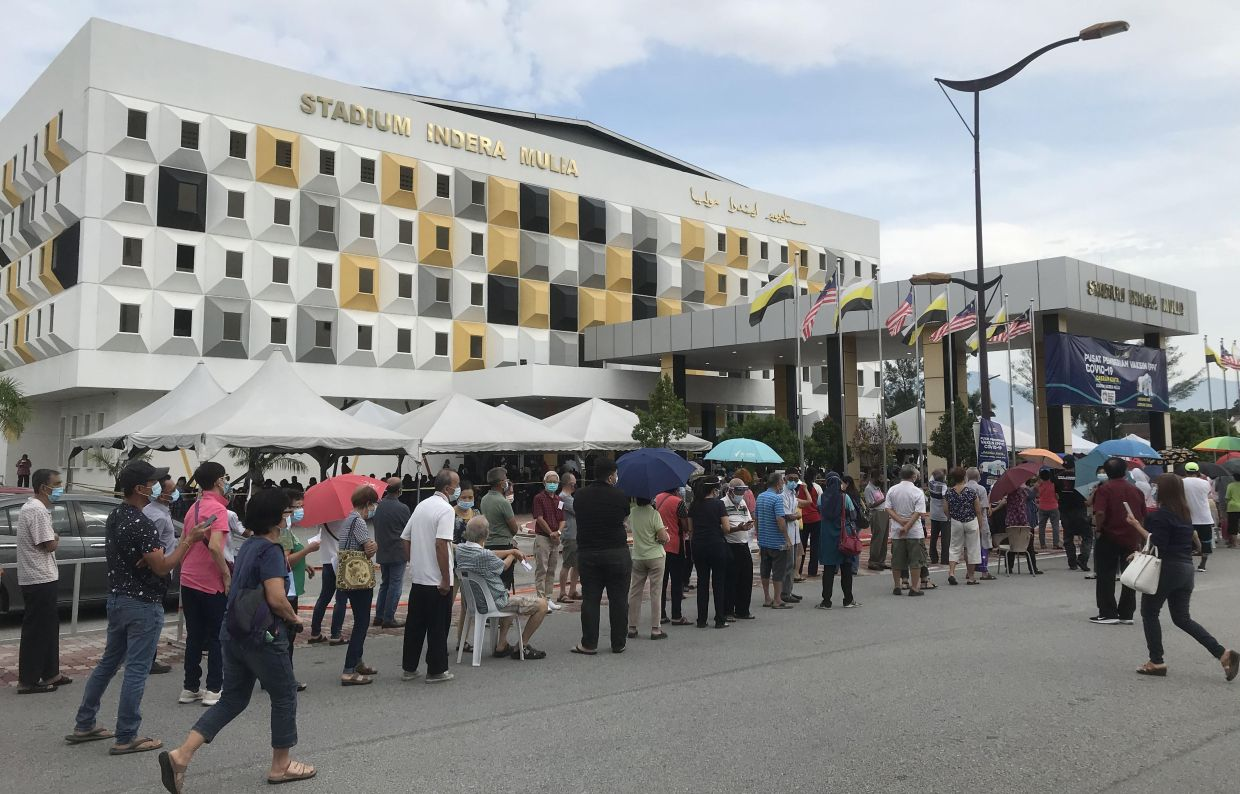 People queuing outside the vaccination centre at Stadium Indera Mulia Ipoh.