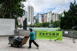 Hong Kong workers reel as minimum wage is frozen
