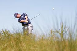 Golf-Mickelson holds PGA Championship lead, Koepka lurks one back