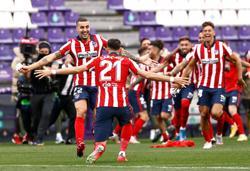 Soccer-Atletico clinch La Liga title thanks to Suarez winner