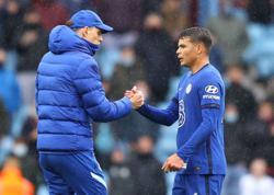Soccer-Chelsea squeeze into Champions League despite defeat at Villa