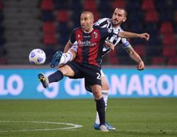 Soccer-Juve thrash Bologna to seal Champions League spot
