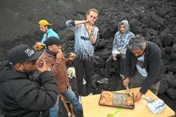 Hot and yummy pizza cooked on smouldering volcanic rock in Guatemala
