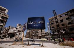 Homs, former rebel stronghold, prepares to vote