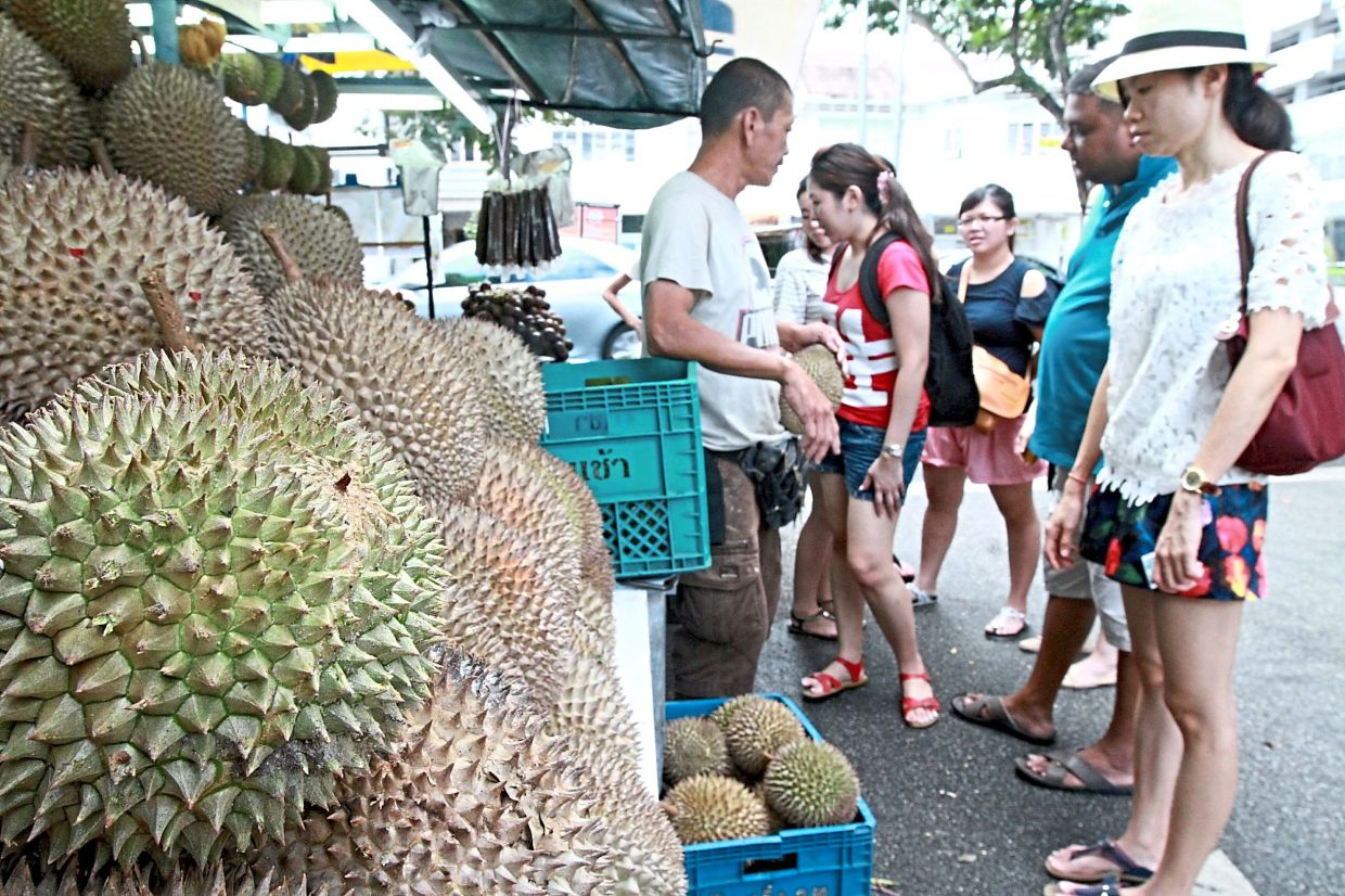 A roadside stall hawker selling durians in George Town a few years ago. Now sellers have an online alternative.