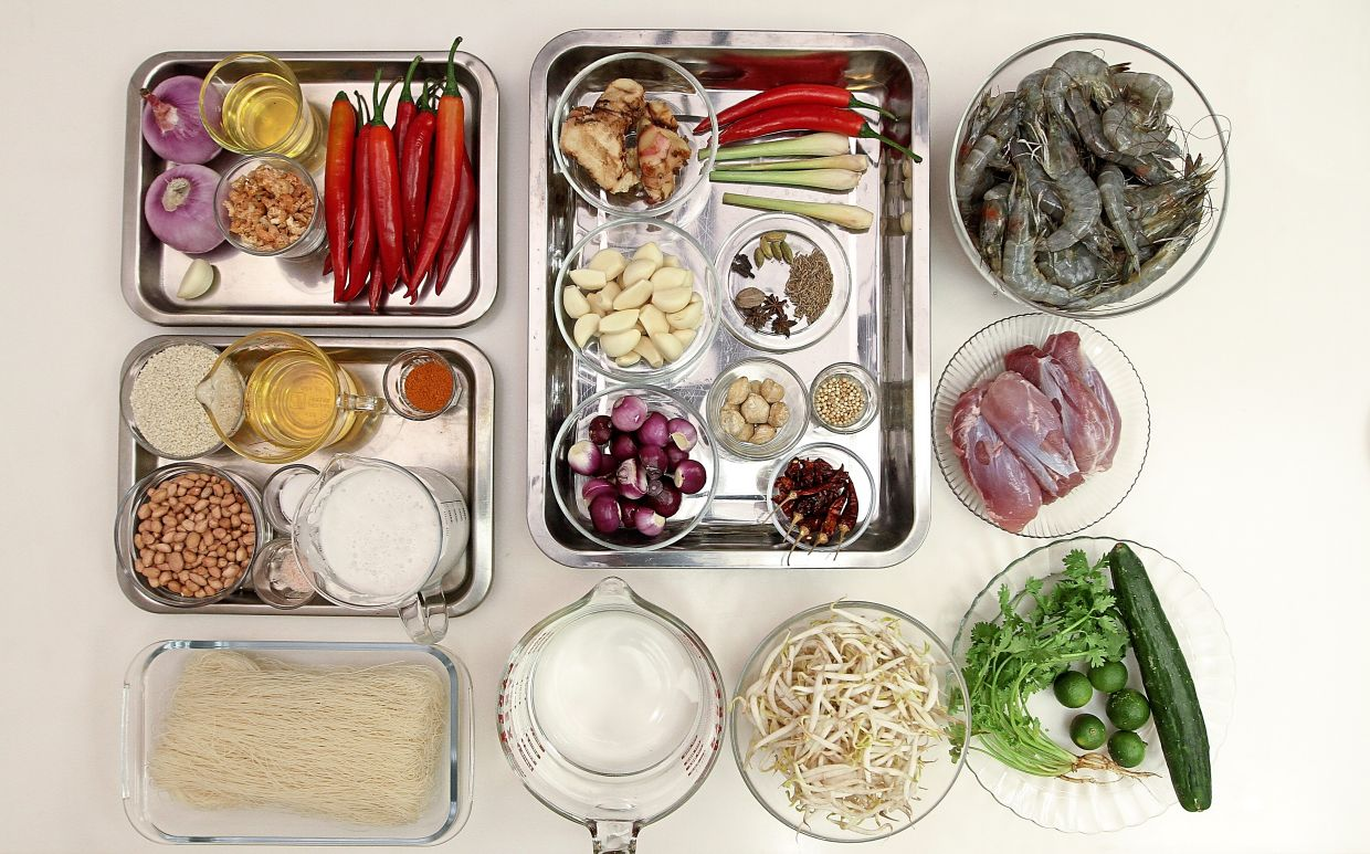 Many ingredients are needed to make the perfect Sarawak laksa. — Photos: YAP CHEE HONG/The Star