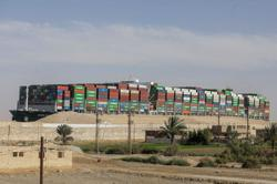 Amid dispute, Suez Canal blames ship's grounding on speed, rudder