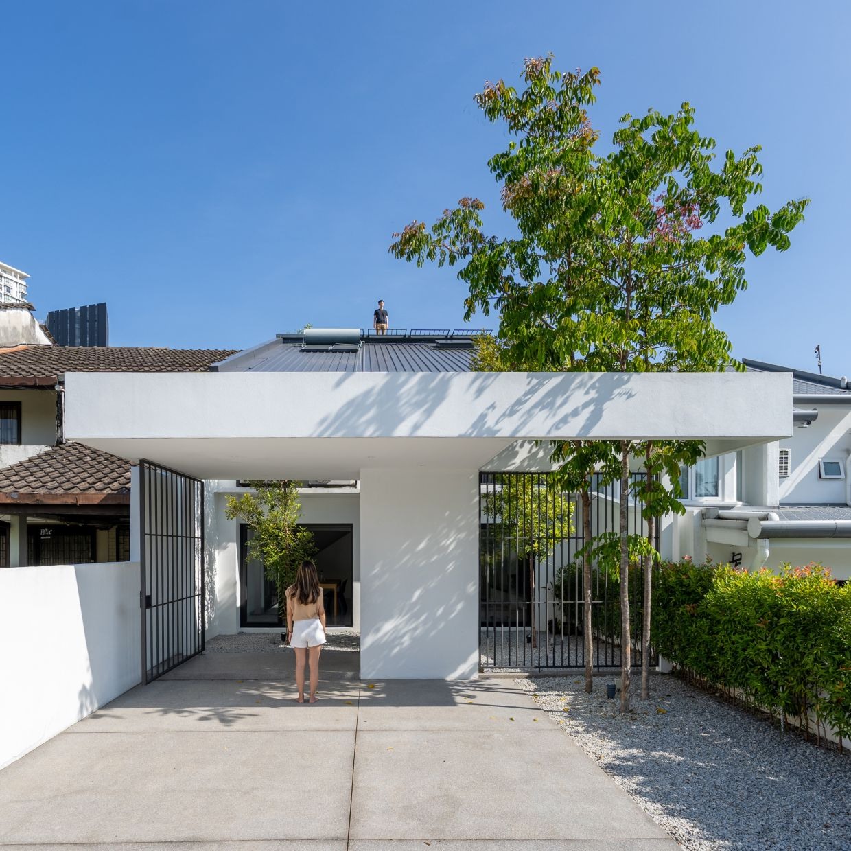 The facade of the house now is a pleasant contrast in relation to its surroundings, and the
