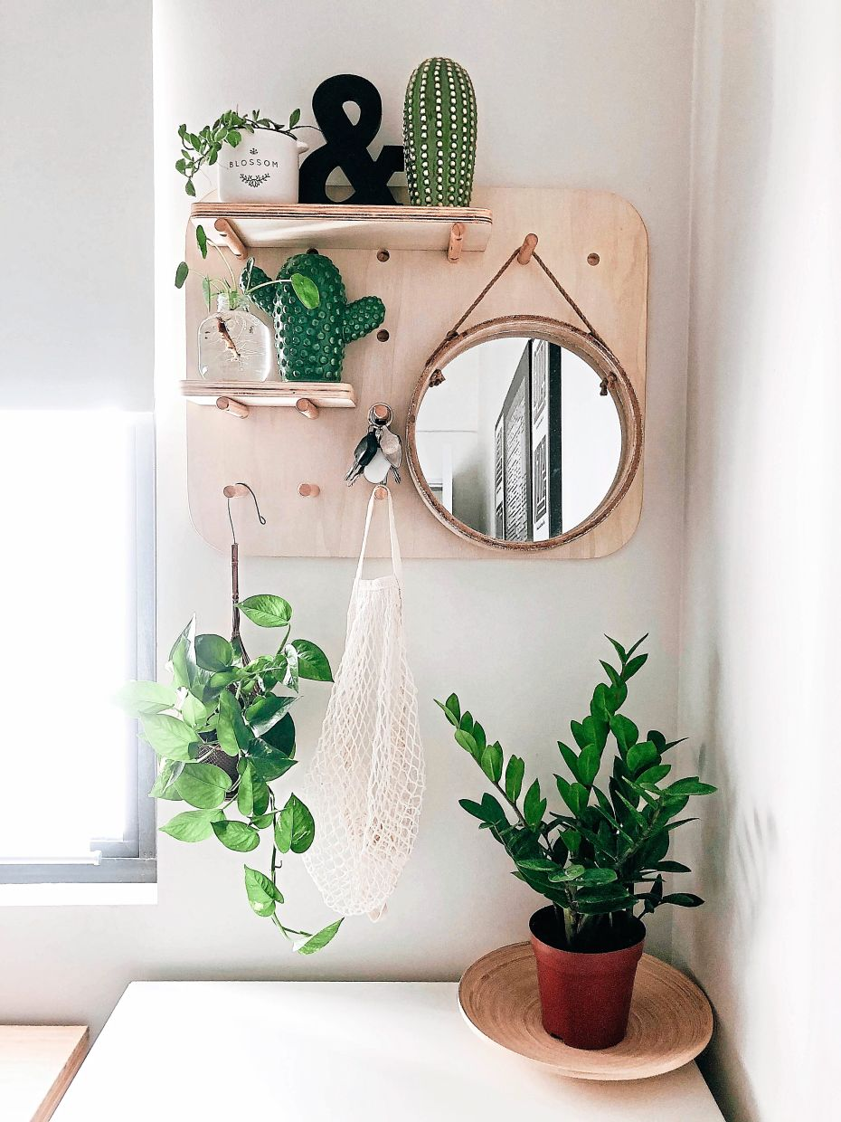 Plants are placed abundantly all over the home to create a serene, soothing feel.