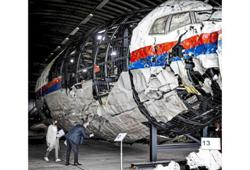 Painful visit to MH17 remains