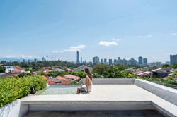 KL terrace house converted into a brighter, breezier space with a rooftop pool