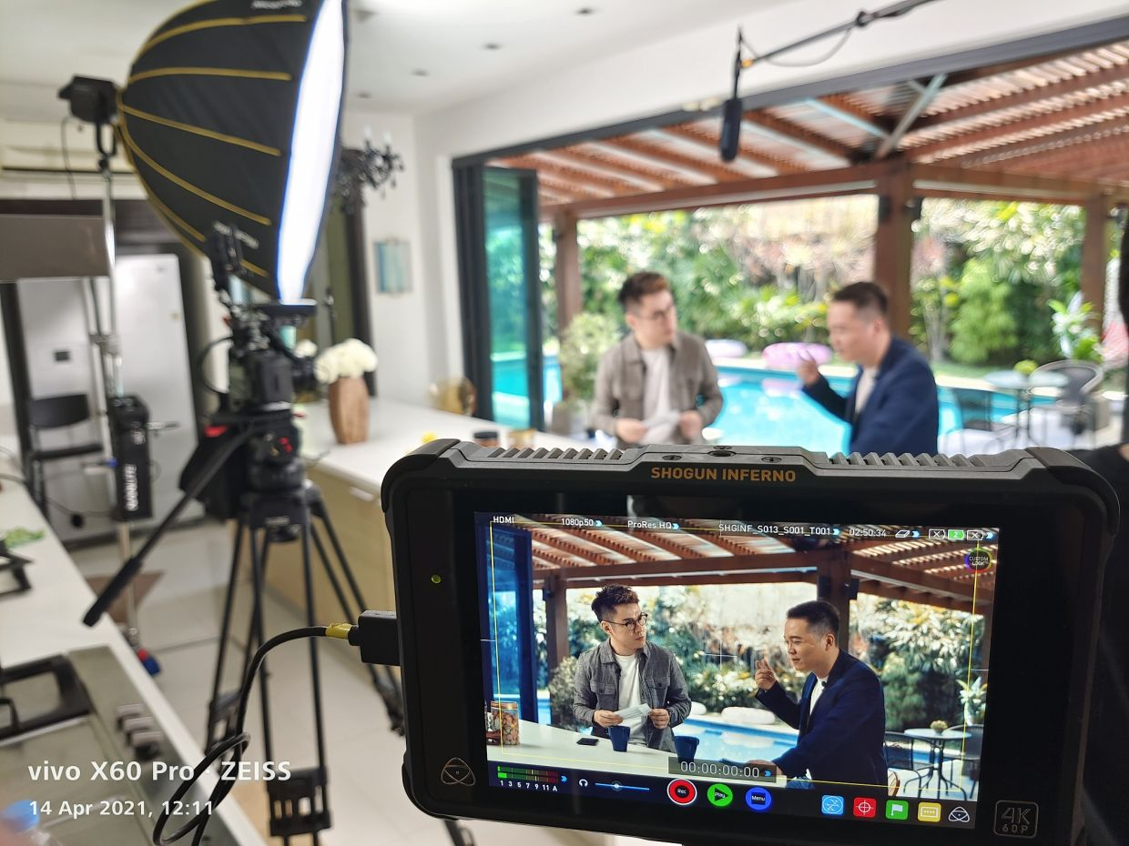 Chan (left) on the set with Xu.