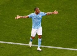 Soccer-Man City's Sterling, Walker receive racist abuse after defeat