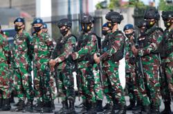 Police arrest 11 suspected militants in Indonesia's Papua