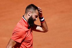 Tennis-Ruud awakening for Paire, but Frenchman the happiest of losers in Paris