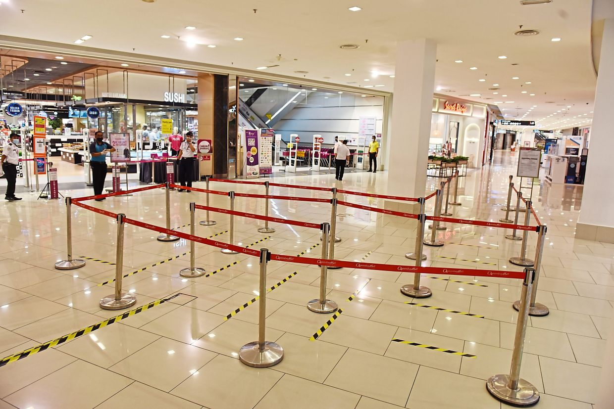 The scene at the entrance to the supermarket in Queensbay Mall devoid of the long queue of customers seen during the weekend.