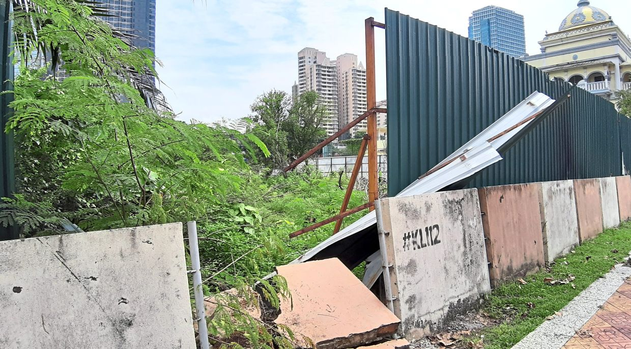 The land surrounding the Cruyff Court in Brickfields is overgrown with shrubs while some of the hoarding has fallen apart.