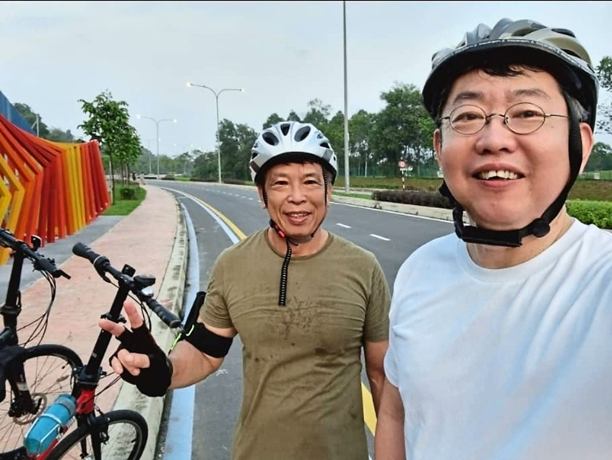 Since the gyms are closed during the MCO, Kok (left) and his good friend Soh Lin Soon started cycling to stay in shape.  Photo: Harry Kok