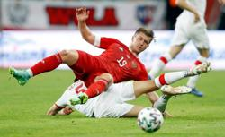 Soccer-Russia hold Poland to 1-1 draw in friendly