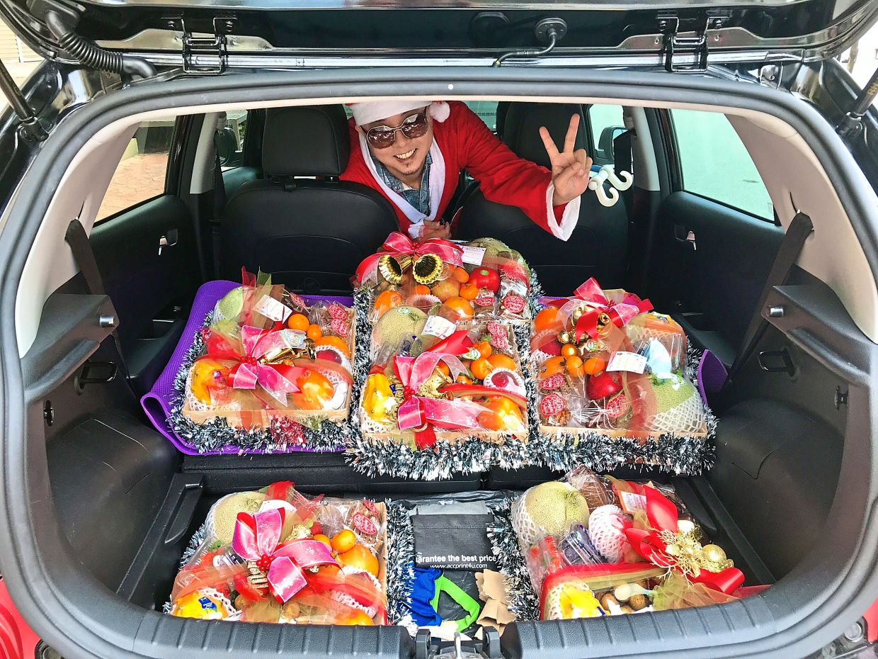 Cheong, dressed as Santa Claus to deliver fruits during Christmas last year, says that it's important to be willing to do what it takes to survive. Photo: Gregory Cheong