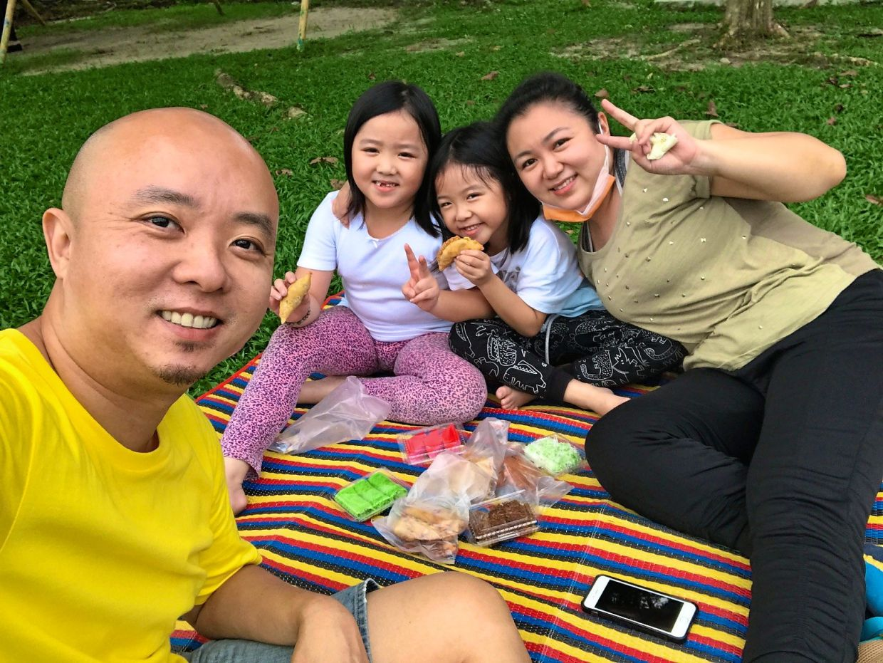Cheong and his wife Wong and their twin daughters during the recovery MCO. Photo: Gregory Cheong