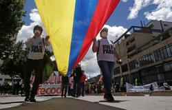 In Colombia, protesters march on as talks stall and blockades remain