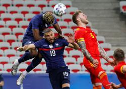 Soccer-No goal, but Benzema shines in France's 3-0 win against Wales