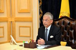 King congratulates two Malaysian cadet officers who got into US military academies