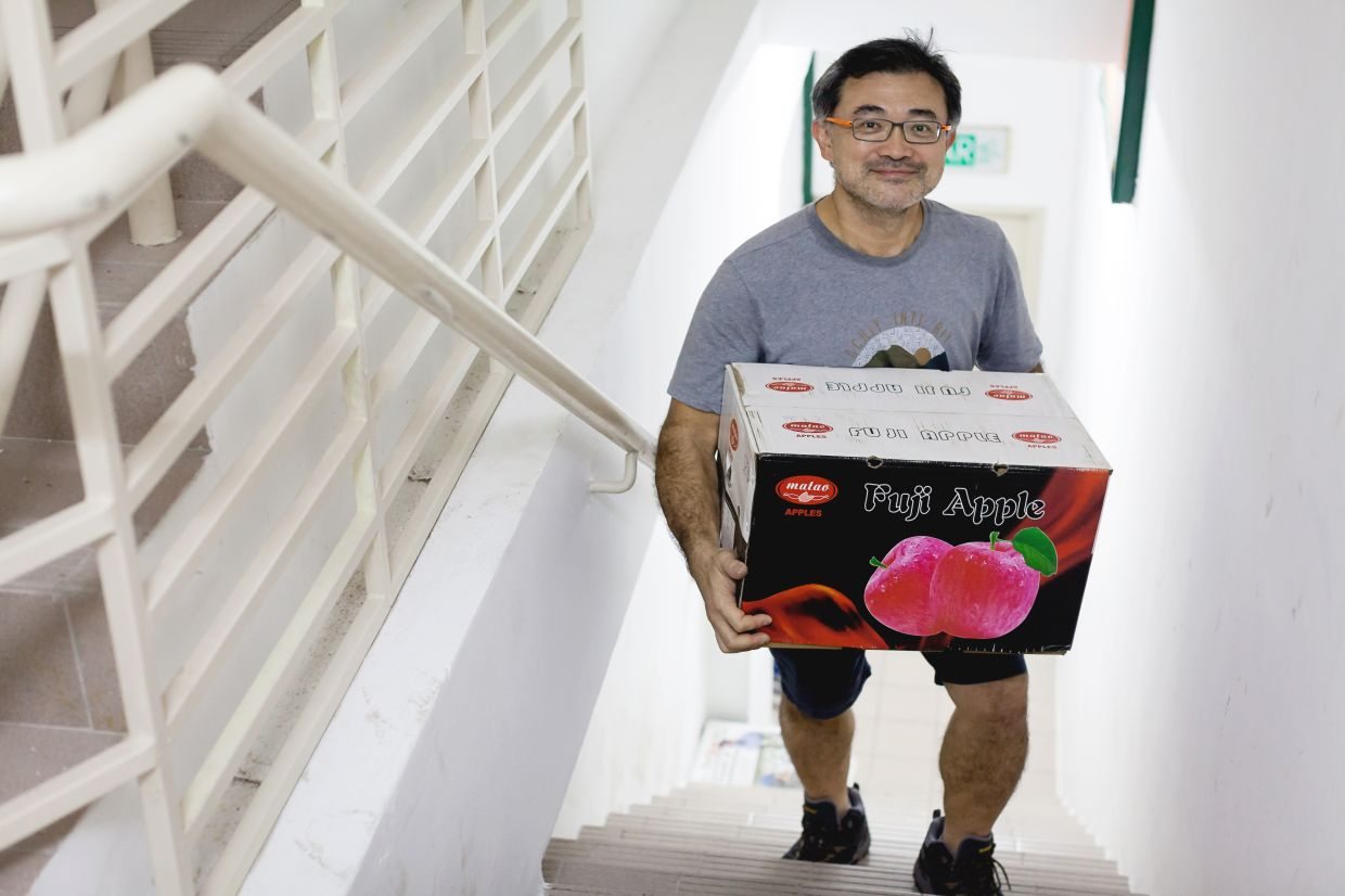 Lau's husband, Francis Tan, helps with deliveries and the purchase of crates of fruit.  Photo: Asther Lau