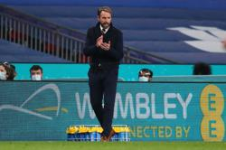 Soccer-Southgate says England 'totally united' in taking a knee at Euros