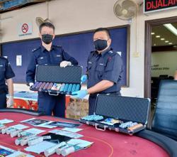 Cops arrest 11 in two anti-gambling raids in Ipoh