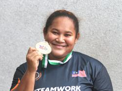 Hammer thrower Grace is not throwing in the towel