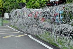 Man finds himself in prickly situation with cops after drunkenly crashing bike into EMCO barbed wire fence