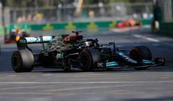 Motor racing-Hamilton's magic deserts him in botched Baku re-start