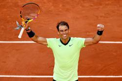 Tennis-Merciless Nadal marches into French Open quarter-finals