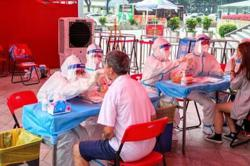 China's Guangdong steps up Covid-19 testing as infections mount