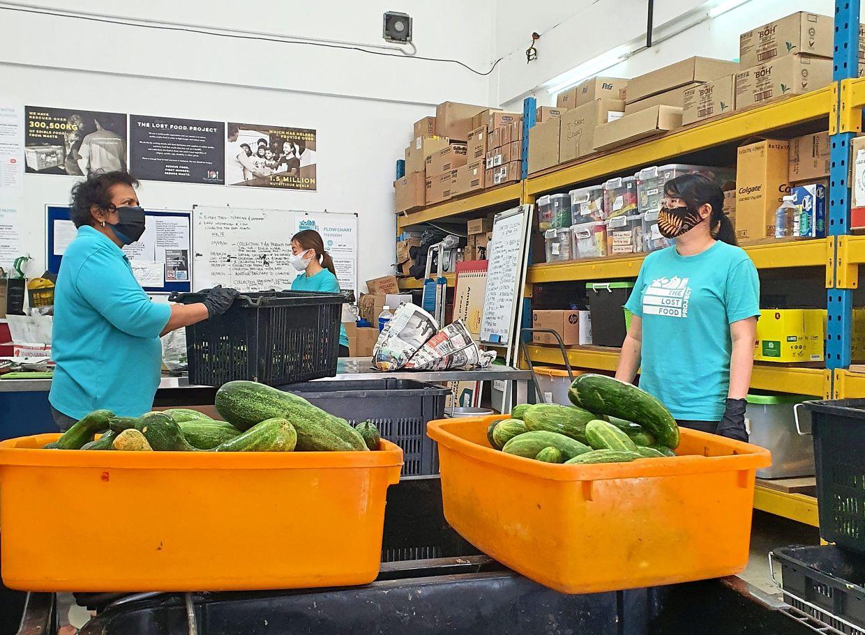 Volunteers at The Lost Food Project food bank  sorting through food collected from Pasar Borong Kuala Lumpur.