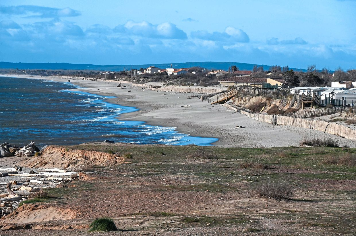 Global warming adds to the strength and frequency of storms that weaken the coastline. — AFP