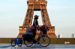 Olympics-Eiffel Tower turns flag-bearer for Paris 2024 ahead of Tokyo handover