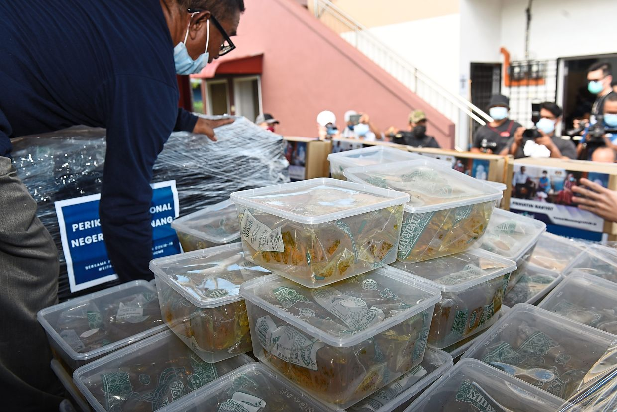 Containers of cooking oil for distribution to the residents.