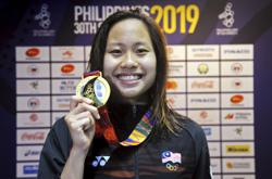 Olympic Games spots looking good for swimmers Welson, Jinq En