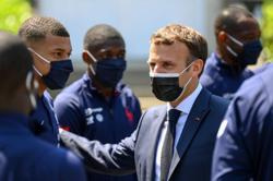 French President Macron urges soccer star Mbappe to stay at PSG