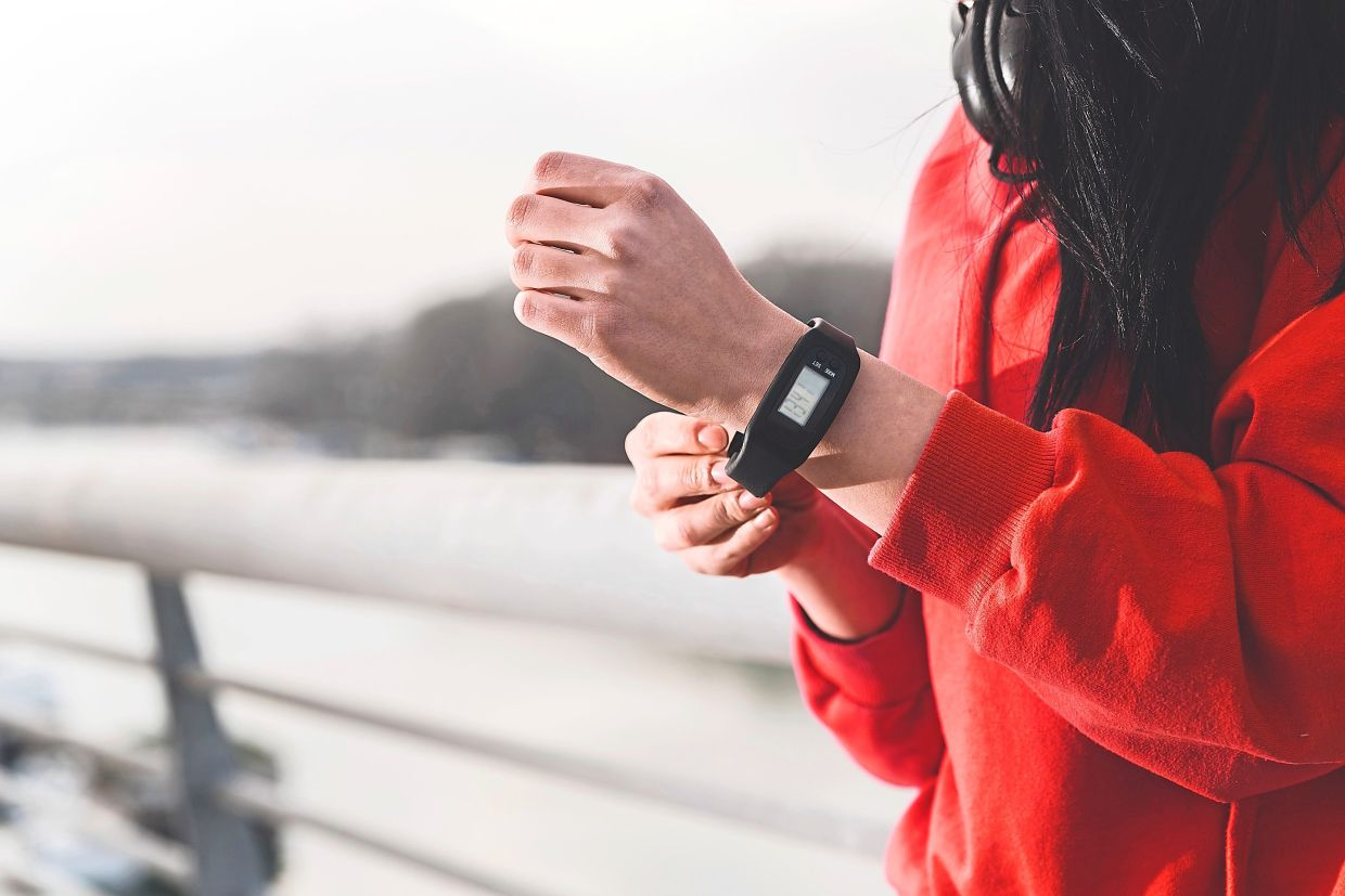 Most of the latest sophisticated fitness trackers today are worn on the wrists and tend to also pick up extra movements from daily life, which are not related to steps.  — Photos: AFP