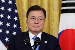 S.Korea's Moon heads for G7 summit overshadowed by China