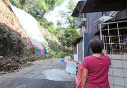 Repair work begins at rear of Sri Lempah flats