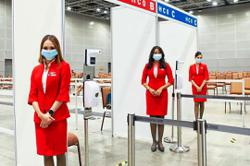 AirAsia crew help out at vaccination centres