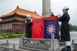 Tokyo says its relationship with Taiwan only unofficial