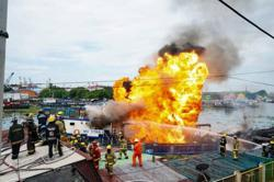 Explosion and fire on cargo vessel hurts six in Philippines