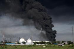 Fire engulfing Pertamina refinery remains ablaze, says CEO